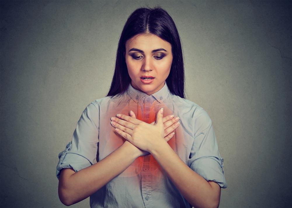 Почему набухает и болит грудь в середине менструального цикла