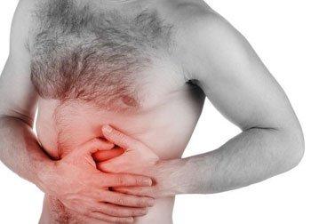 Почему болит слева под ребрами со стороны спины и что делать?